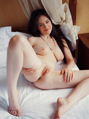 """A glamorous, seductive maiden, Annis   dazzles us with her voluptuous body   with puffy large breasts and pink,   delectable pussy in a bedroom"