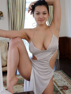 """Blessed with enviable flexible body and well-endowed assets, Sofi gracefully poses in her sexy long gown that perfectly hugs her beautiful, larg"