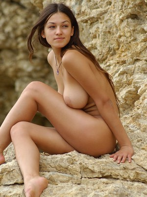 """Flexible Sofia A poses nude on the rocks """
